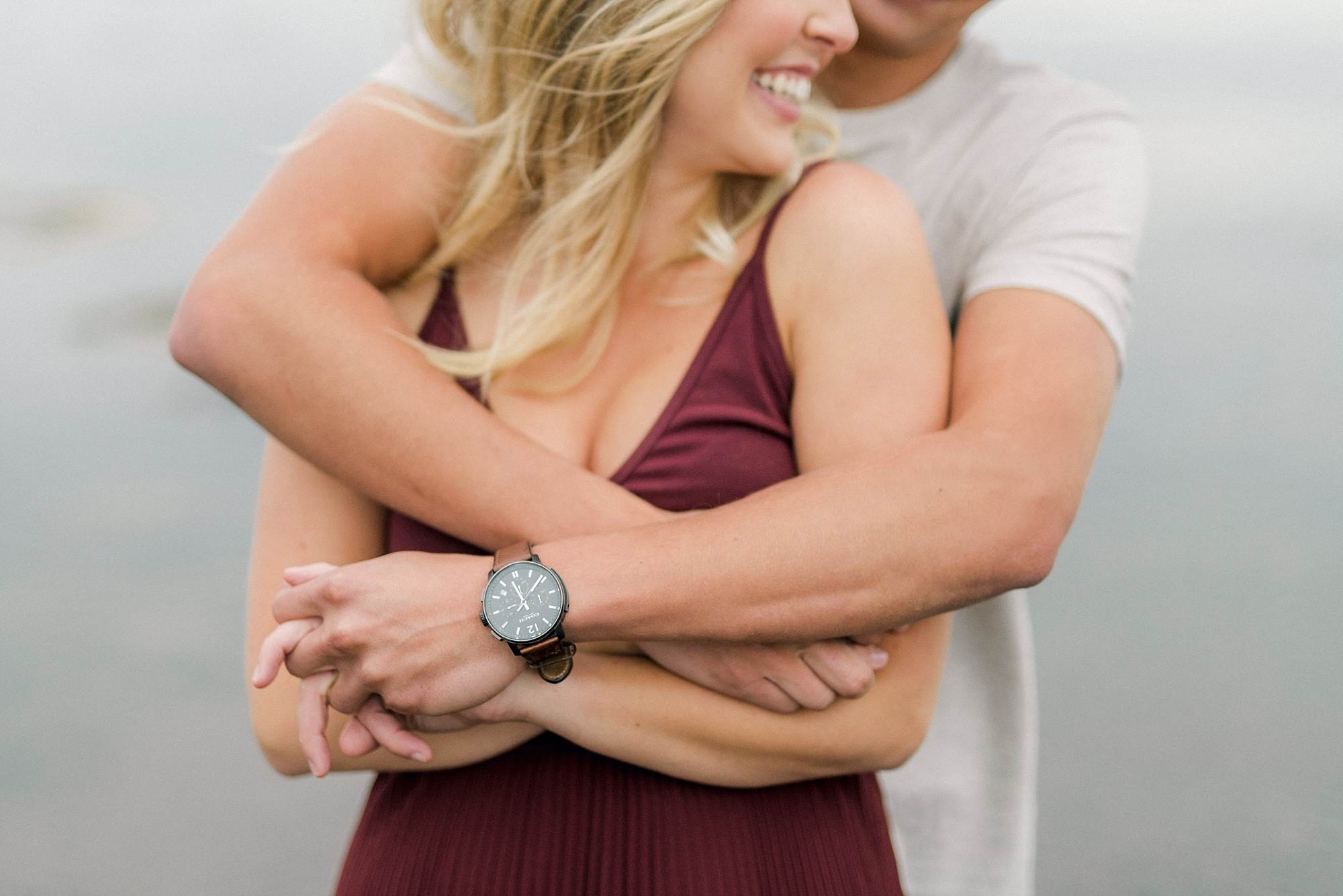 arms wrapped around a girl in a hug