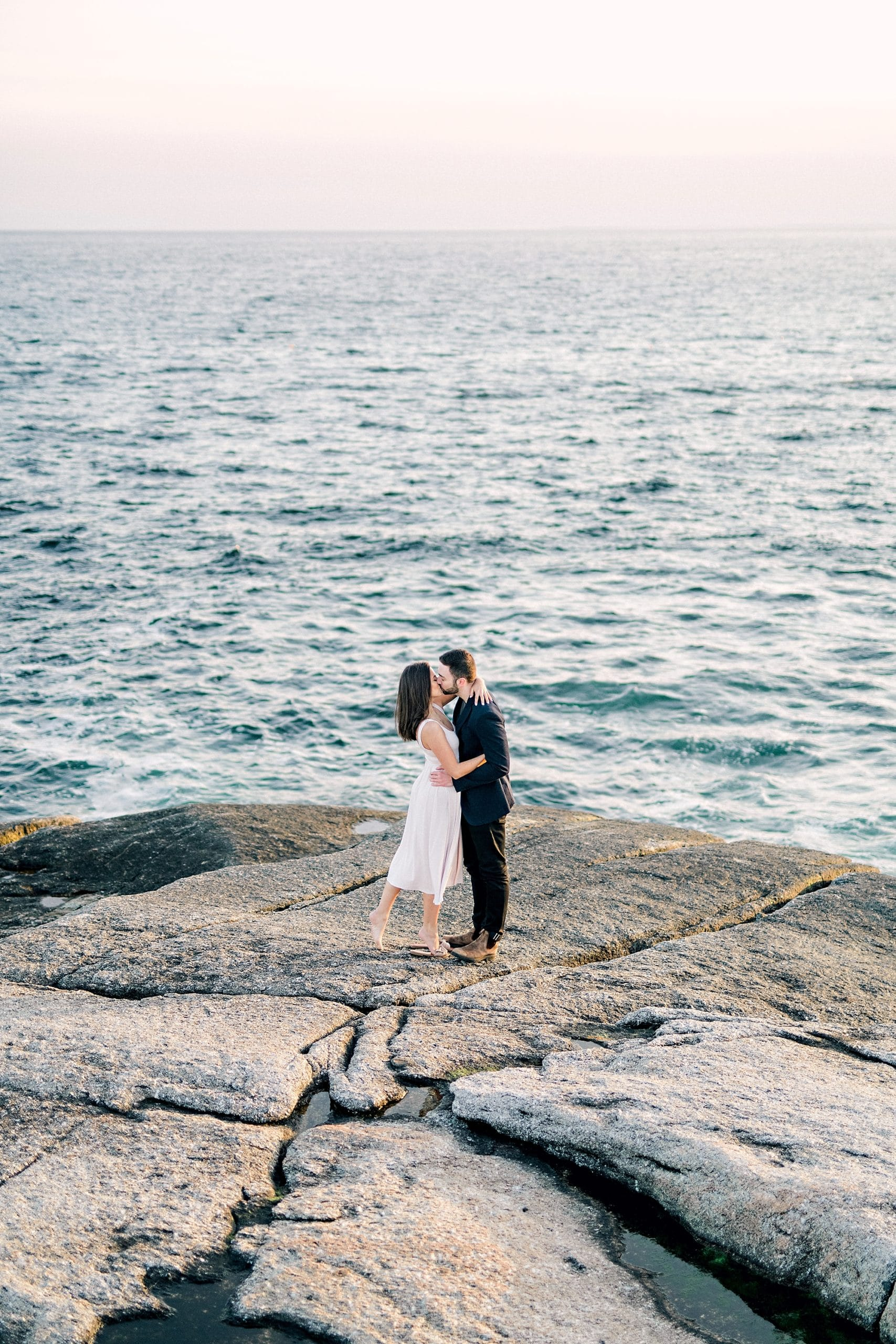 girl and guy dancing by the ocean