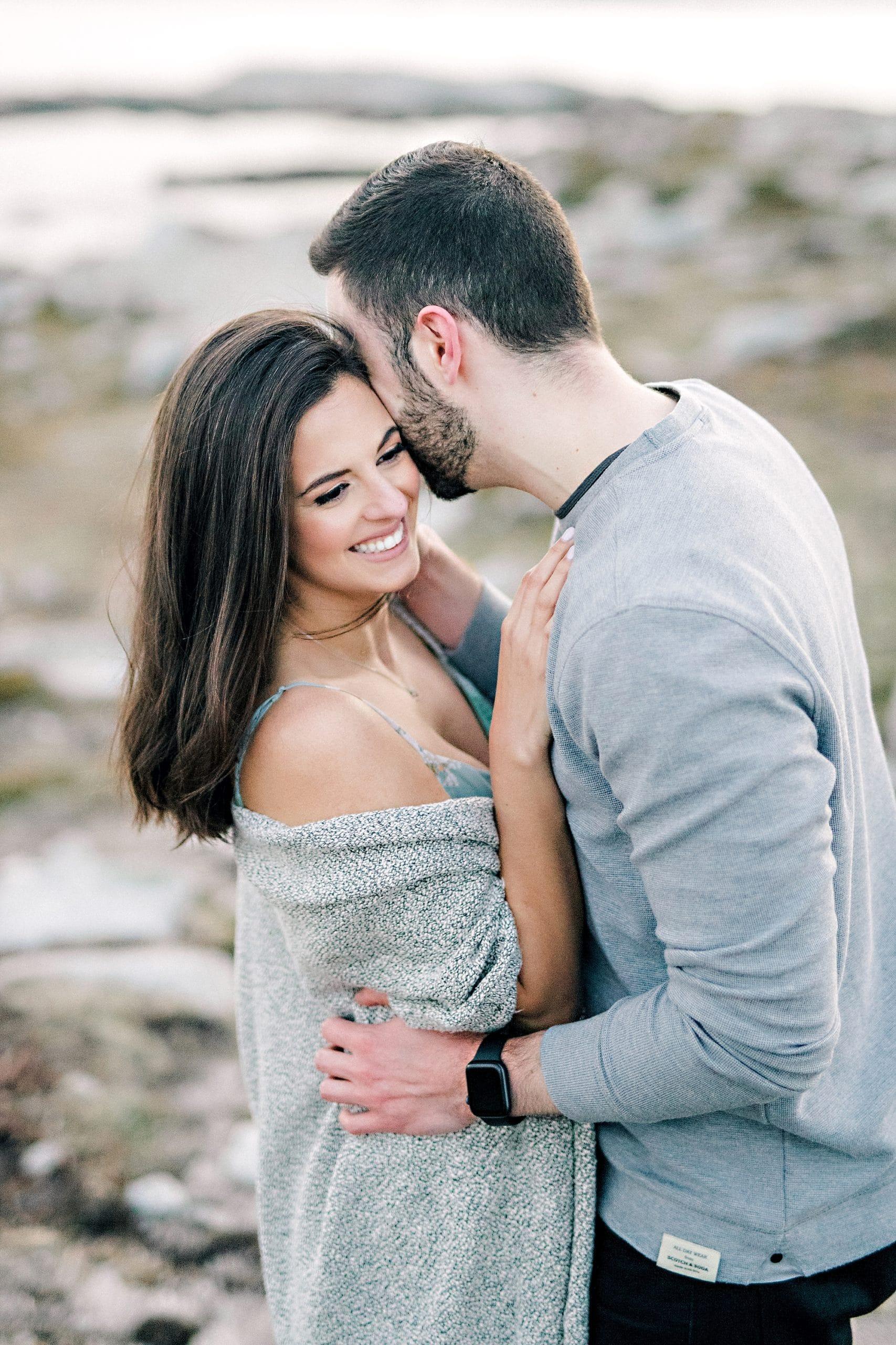 guy kissing girlfriends cheek
