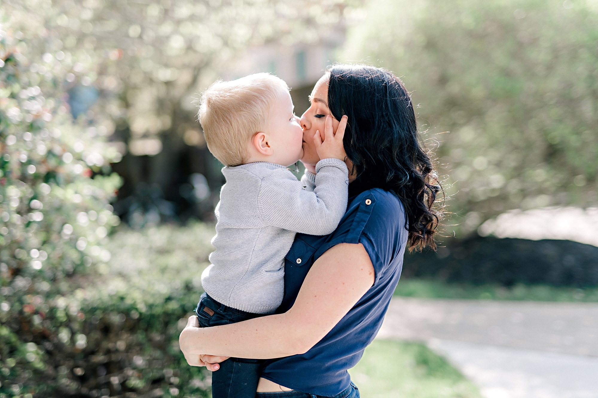 little boy kissing his mother at family photos