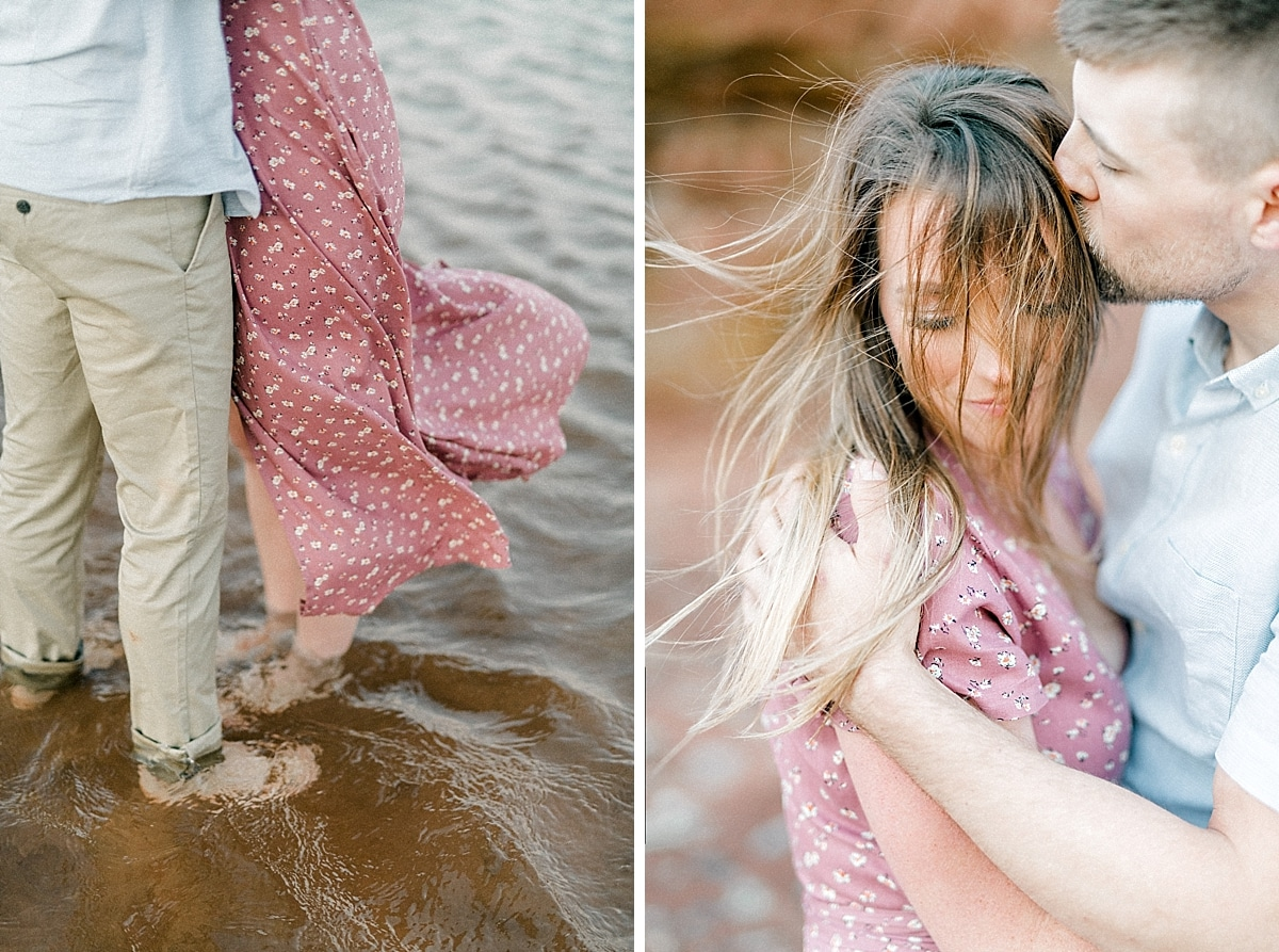 wind blowing the pink skirt of a girl standing in the ocean while her hair is blowing